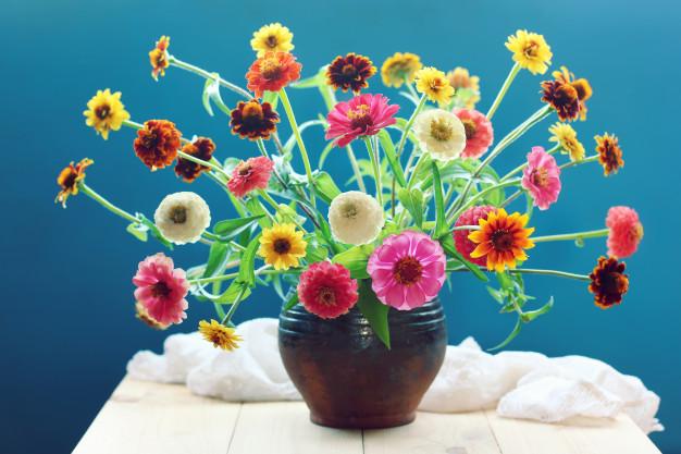 bouquet-garden-yellow-pink-flowers-blue-background_92795-372.jpg