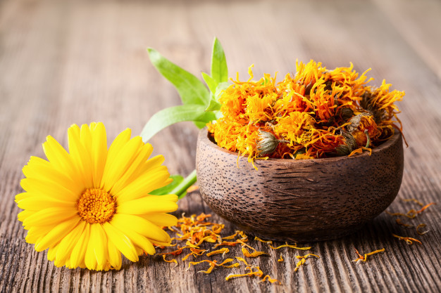dried-fresh-marigold-calendula-flowers-bowl-wooden-rustic-background_100801-19.jpg
